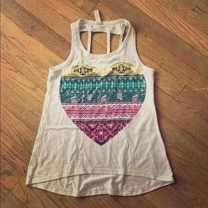 A white tank top with a colorful heart in the mid.